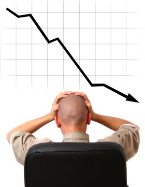 downward chart man holding head