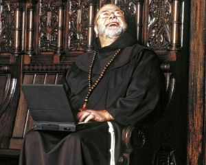 priest with laptop