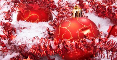 Christmas balls with snow close-up