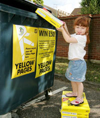 girl throwing out phonebooks